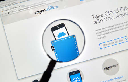 MONTREAL, CANADA - MAY 8, 2016 : Amazon Cloud Drive web page under magnifying glass. Amazon Cloud Drive is a web storage application from Amazon.