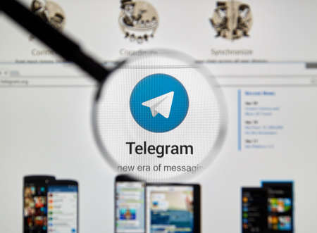 telegrama: MONTREAL, CANADA - MAY 8, 2016 : Telegram messnger web site under magnifying glass. Telegram is a cloud-based instant messaging service.
