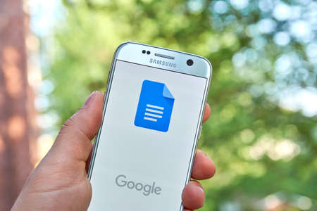 docs: MONTREAL, CANADA - MAY 23, 2016 : Google Docs application on Samsung S7 screen. Google Docs is a free Web-based application in which documents and spreadsheets can be created, edited and stored online