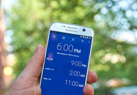 samsung: MONTREAL, CANADA - MAY 23, 2016 : Google Clock android application on Samsung S7 screen.