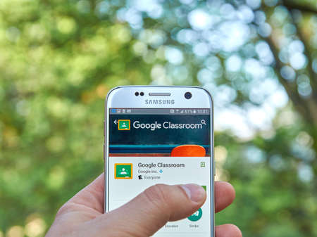 distributing: MONTREAL, CANADA - MAY 23, 2016 : Google Classroom application on Samsung S7 screen. Google Classroom is a tool for teachers to distributing and collecting work. Editorial