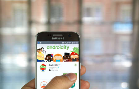 accessorize: MONTREAL, CANADA - MAY 23, 2016 : Google application on Samsung S7 screen. Androidify is an app to create, accessorize and share Android characters. Editorial