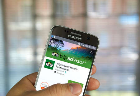 MONTREAL, CANADA - MAY 23, 2016 : TripAdvisor application on Samsung s7 phone screen. TripAdvisor, Inc. is an American travel website company providing reviews of travel-related content.