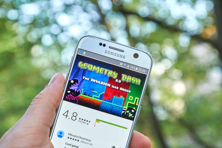media gadget: MONTREAL, CANADA - MAY 23, 2016 : Geometry Dash game on Samsung S7 screen. Geometry Dash is a 2013 mobile game and Steam game developed by Sweden-based developer Robert Topala