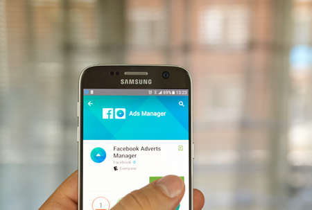google play: MONTREAL, CANADA - JUNE 24, 2016 : Facebook Ads Manager on Samsung S7 screen. Ads Manager is built to help Facebook advertisers manage and create ads from mobile devices.