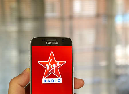 google play: MONTREAL, CANADA - JUNE 24, 2016 : Virgin Radio android application on Samsung S7 screen. Virgin Radio is a brand owned by the Virgin Group. Editorial