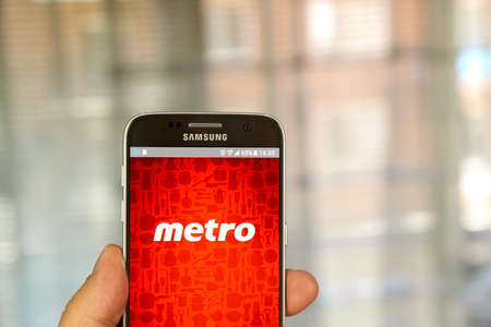 samsung: MONTREAL, CANADA - JUNE 24, 2016 : Metro android application on Samsung S7 screen. Metro Inc. is food retailer operating in the Canadian provinces of Quebec and Ontario.