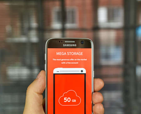 mega phone: MONTREAL, CANADA - JULY 7, 2016 : Mega - online storage on android cell phone. Mega is a cloud storage and file hosting service produced by Mega Limited. Editorial