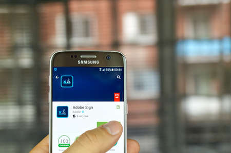 integrates: MONTREAL, CANADA - JULY, 15 : Adobe application on Samsung s7 screen. Adobe Sign is an e-signature solution that completely and seamlessly integrates with NetSuite.