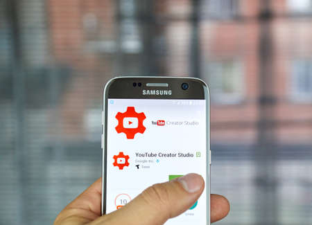 logo samsung: MONTREAL, CANADA - JUNE 23, 2016 : YouTube Creator Studio app makes it faster and easier to manage users channel on the go.