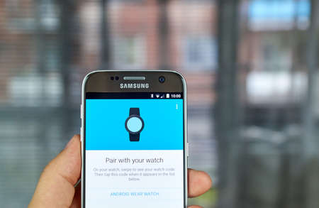 samsung: MONTREAL, CANADA - JUNE 23, 2016 : Google Android Wear smartwatch application on Samsung S7 screen. The app allows to connect Android Wear smartwatch with android phone.