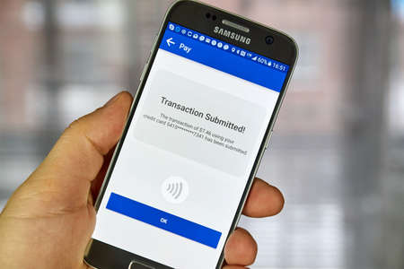 MONTREAL, CANADA - DECEMBER 23, 2016 : NFC payment android application on Samsung S7 screen. Editorial
