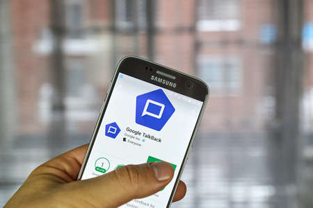 impaired: MONTREAL, CANADA - DECEMBER 23, 2016 : Google TalkBack is an accessibility service that helps blind and vision-impaired users interact with their devices
