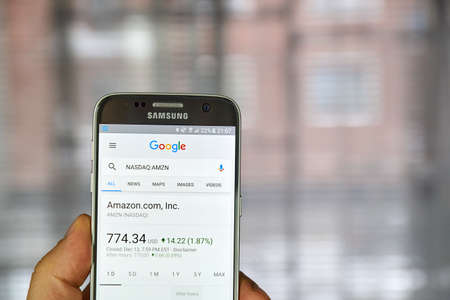amazon com: MONTREAL, CANADA - DECEMBER 23, 2016 : Google Finance page with stock chart and Amazon ticker on Samsung S7 screen.