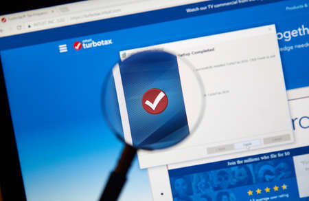 earned: MONTREAL, CANADA - FEBRUARY 12, 2017 - Turbotax software app under magnifying glass. Turbotax is an application for accurate tax calculations.