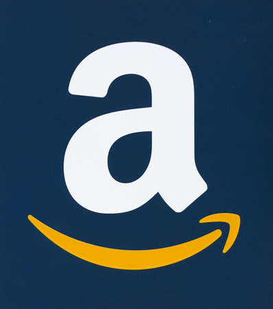 MONTREAL, CANADA - FEBRUARY 28, 2017: Amazon logo printed on a blue paper. Amazon is an American electronic commerce and cloud computing company that was founded on July 5, 1994 by Jeff Bezos. Editorial