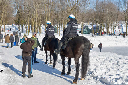 MONTREAL, CANADA - FEBRUARY 2, 2017: - Montreal Mounted Patrol officers in Mont-Royal park.