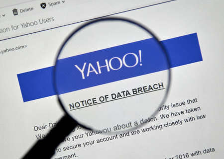 MONTREAL, CANADA - DECEMBER 15, 2016 : Yahoo Notice of data breach under magnifying glass.