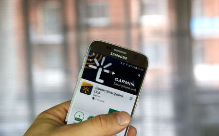 MONTREAL, CANADA - MARCH 10, 2017 : Garmin Spartphone Link app on Samsung s7 screen. Garmin is an American multinational technology company founded by Gary Burrell and Min Kao in 1989.