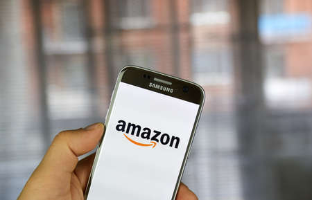 MONTREAL, CANADA - MARCH 20, 2017 - Amazon mobile application on screen of Samsung S5 in hand. Amazon is an American electronic commerce and cloud computing company.
