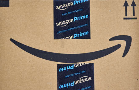MONTREAL, CANADA - MARCH 28, 2017: Amazon Prime shipping box with branded tape on it. Amazon is an American electronic commerce and cloud computing company. Editorial