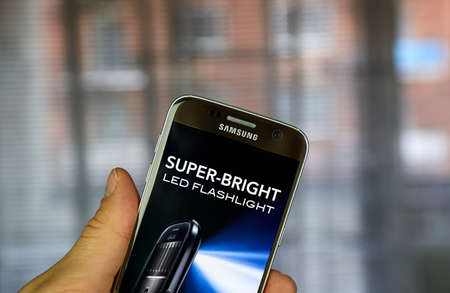 MONTREAL, CANADA - MARCH 10, 2017 : Super-Bright LED Flashlight app on Samsung S7. It turnes users phone into a bright flashlight by accessing camera LED light.