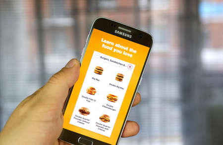 mcdonalds: MONTREAL, CANADA - APRIL 20, 2017 - McDonalds application on Samsung S7 screen. McDonalds is the worlds largest chain of hamburger fast food restaurants. Editorial