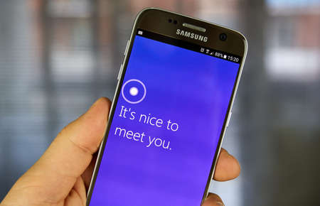 MONTREAL, CANADA - JULY 30, 2017 : Cortana app on Android cell phone. Cortana is an intelligent personal assistant created by Microsoft for Windows 10, Windows 10 Mobile