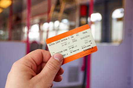 LONDON, ENGLAND - MAY 14, 2017 : UK Rail National single offpeak standard ticket. In the United Kingdom, National Rail is the trading name licensed for use by the Rail Delivery