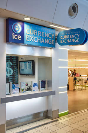 nyse: LONDON, ENGLAND - MAY 14, 2017 : ICE currency exchange office in airport. Intercontinental Exchange, Inc. is an American network of exchanges and clearing houses for financial and commodity markets Editorial