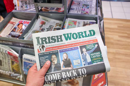articles: LONDON, ENGLAND - MAY 14, 2017 : The Irish World newspaper an a newspapers background. The Irish World is a weekly newspaper for Irish people in Britain and their families.