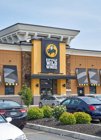 PLATTSBURGH, USA - AUGUST 23, 2017 : Buffalo Wild Wings restaurant and logo. Buffalo Wild Wings is an American casual dining restaurant and sports bar franchise