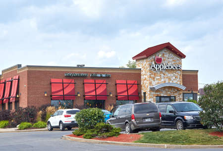 PLATTSBURGH, USA - AUGUST 23, 2017 : Applebees restaurant and parking. Applebees International, Inc., is an American company which develops, franchises, and operates its chain