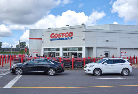 MONTREAL, CANADA - AUGUST 25, 2016 : Costco Wholesale store and logo. Costco Wholesale Corporation trading as Costco, is the largest American membership-only warehouse club