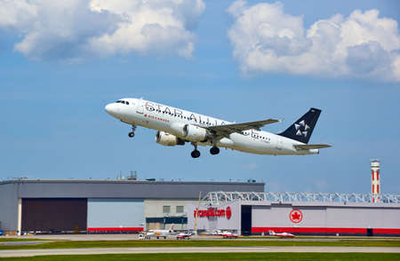 MONTREAL, CANADA - AUGUST 28, 2017 : Air Canada Star Aliance taking off plane. Star Alliance is one of the worlds largest global airline alliances, founded on 14 May 1997