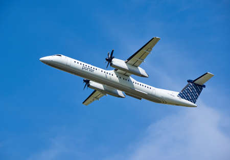 MONTREAL, CANADA - AUGUST 28, 2017 : Porter Airlines taking off plane. Porter Airlines is a regional airline headquartered at Billy Bishop Toronto City Airport on the Toronto Islands in Toronto