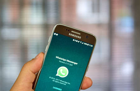 MONTREAL, CANADA - SEPTEMBER 28, 2017 - Whatsapp mobile application on screen of Samsung S7. WhatsApp Messenger is a freeware and cross-platform instant messaging service for smartphones