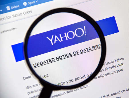MONTREAL, CANADA - OCTOBER 9, 2017 : Yahoo updated Notice of data breach under magnifying glass. Yahoo! is a web services provider Editorial