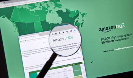 MONTREAL, CANADA - OCTOBER 24, 2017: Amazon second headquarter description and map on official website under magnifying glass. Amazon HQ2 will be Amazons second headquarters in North America. Editorial