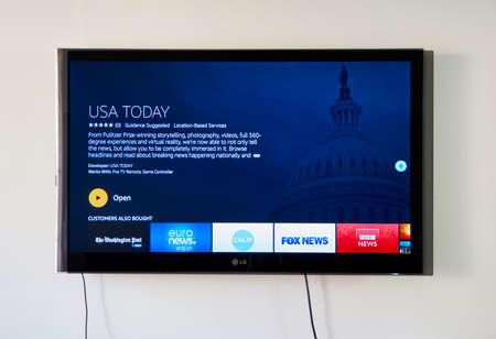 MONTREAL, CANADA - NOVEMBER 15, 2017: USA Today on LG TV. USA Today is an internationally distributed American daily newspaper that serves as the flagship publication of its owner the Gannett Company Redakční