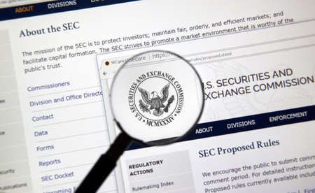 MONTREAL, CANADA - NOVEMBER 7, 2017: SEC webpage under magnifying glass. The U.S. Securities and Exchange Commission is an independent agency of the United States federal government.