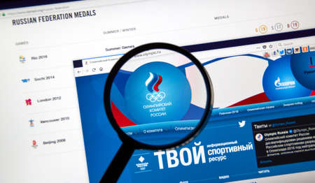 MONTREAL, CANADA - DECEMBER 5, 2017: Russian Olympic Committee web page under magnifying glass.