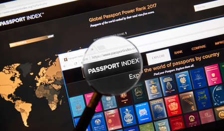 MONTREAL, CANADA - MARCH 10, 2018: Passport index web page under magnifying glass. Passport Index is a global ranking of countries according to the travel freedom that their citizens enjoy.