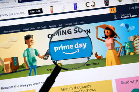 MONTREAL, CANADA - JUNE 10, 2018 : Amazon prime day page on official amazon site under magnifying glass. Amazon Prime Day is the retailers big members-only summer sale in month of July each year.