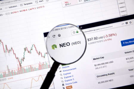 MONTREAL, CANADA - JUNE 20, 2018: Neo crypto currency price under magnifying glass. Cryptocurrency is a digital currency in which encryption techniques are used to generate and transfer funds.