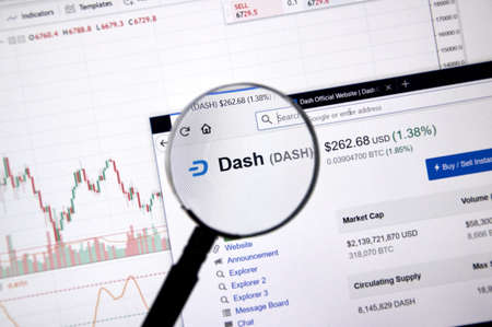 MONTREAL, CANADA - JUNE 20, 2018: Dash crypto currency price under magnifying glass. Cryptocurrency is a digital currency in which encryption techniques are used to generate and transfer funds.