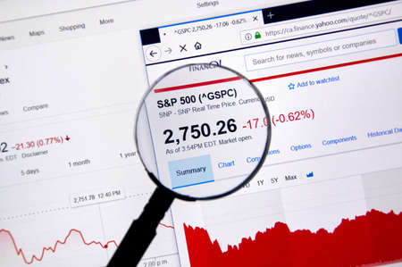 MONTREAL, CANADA - JUNE 10, 2018: sp 500 index price with charts under magnifying glass