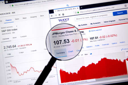 MONTREAL, CANADA - JUNE 22, 2018: JPMorgand Chase ticker with shares price and charts under magnifying glass on Yahoo Finance.