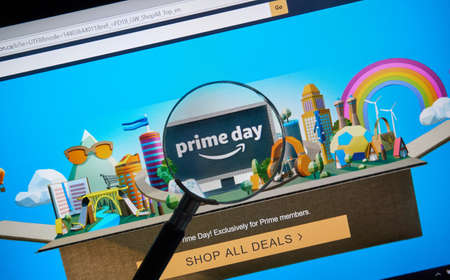 MONTREAL, CANADA - JULY 16, 2018 : Amazon prime day page on official amazon site under magnifying glass. Amazon Prime Day is the retailer's big members-only summer sale in month of July each year. Редакционное