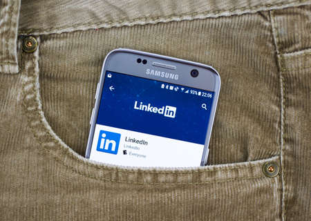 MONTREAL, CANADA - AUGUST 10, 2018: Linkedin app on a cellphone screen in a jeans pocket. LinkedIn is a social networking site designed specifically for the business community.